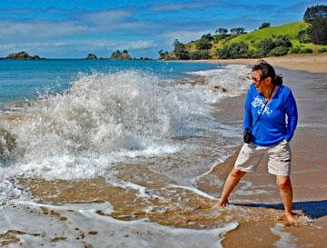 Enjoying the beach at Tauranga Bay