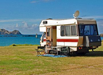 Waterfront camping at Tauranga Bay Holiday Park