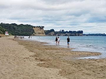 Strolling along the beach at Long Bay on Auckland's North Shore