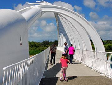The Te Rewa Rewa bridge with Mount Taranaki hiding behind cloud