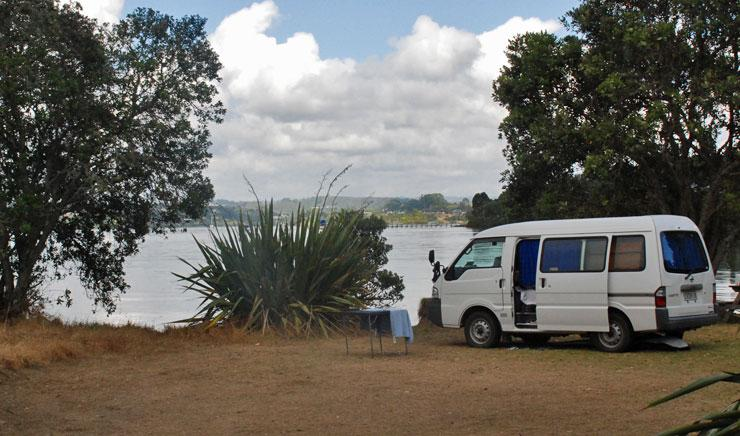 Van parked by the water in a non-powered site