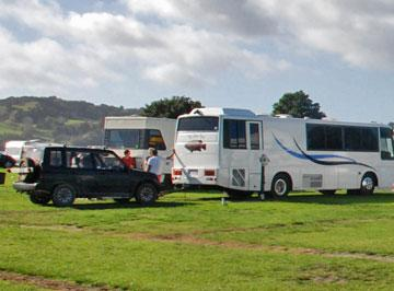 Large motorhome towing a small utility car