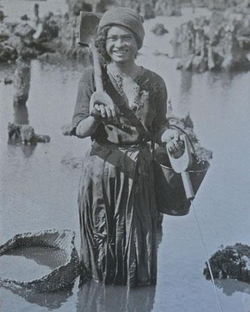 Maori girl working in the swamps