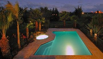 The swimming pool lit up at night