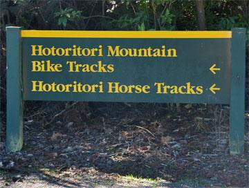 Sign pointing to the mountain bike and horse tracks