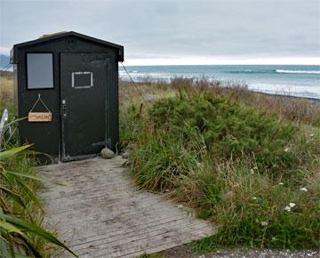 Public toilet at the far end of the beach