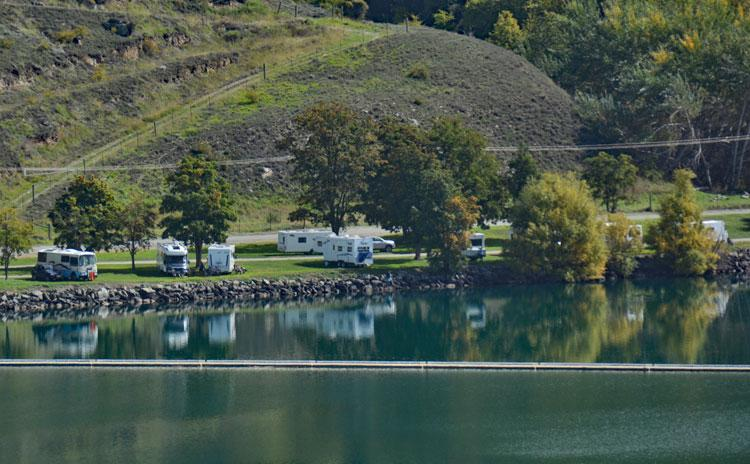 Motorhomes parked on the other side of the lake