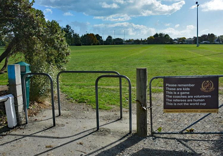 Entrance to the sports ground - with advisory sign...