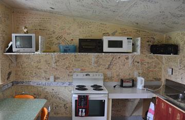 Kitchen -with graffiti decorated walls and ceiling