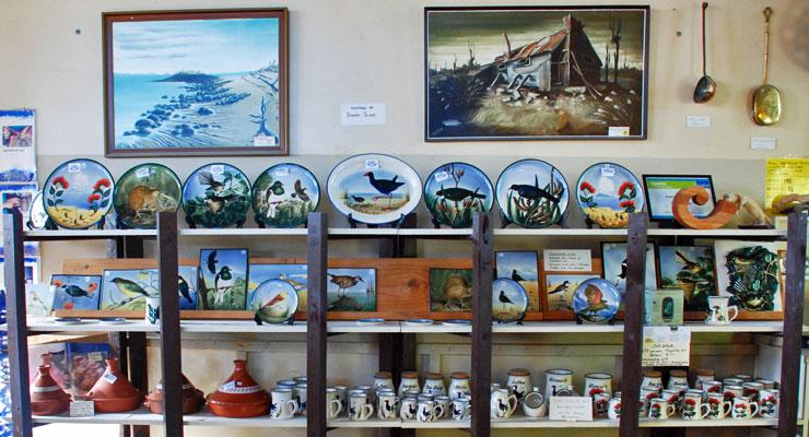 A selection of pots and hand-painted platters on display in the pottery